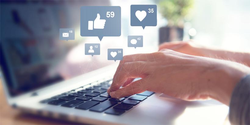 Bild von Händen tippend an einer Tastatur - im Vordergrund verschiedene Grafiken von Icons