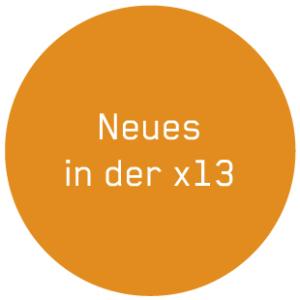 """Button """"Neues in der x13"""" in Orange"""